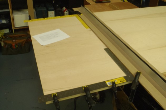 Rough Cutting Plywood.  Construction squares are used to place the cutting guide.